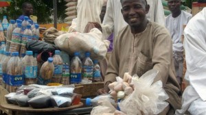 TO GO WITH AFP STORY BY AMINU ABUBAKAR A vendor of herbal aphrodisiacs Muhammad Ma'aruf, 65, displays on June 6, 2009 sex stimulants outside the Sabon-Gari market in Kano, northern Nigeria's commercial capital. Men trying to keep several wives happy and women competing with co-wives for their husbands' attentions has led to a boom in the sale of herbal aphrodisiacs in predominantly Moslem northern Nigeria. Women not satisfied with their husband's sexual performance also come for the drugs if their husbands are embarrassed to do so. The drugs come in all forms -- liquid, jelly and powder and are taken orally or rubbed on the penis. The recipes are handed down from father to son and are a jealously guarded secret.      AFP PHOTO / AMINU ABUBAKAR