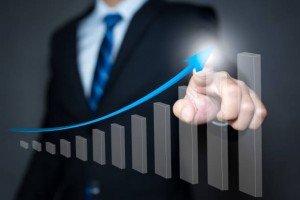 Businessman pointing arrow graph and chart, corporate growth plan or business development to success and growing growth concept.