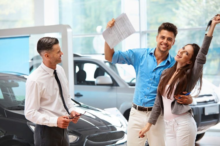 happy-couple-buying-car-sales-dealership-760x507