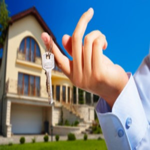 House owner/real estate agent giving away the keys - house out of focus