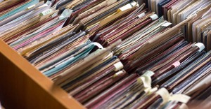 File folders in a file cabinet card catalog in a library closeup