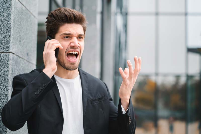 Businessman screaming on mobile phone. Having nervous breakdown at work, screaming in anger, stress management, mental distress problems, losing temper, reaction on failure.