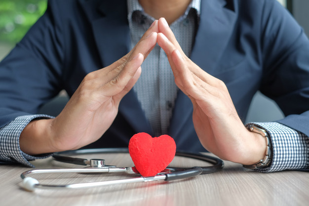 businessman-hands-over-heart-and-stethoscope-healthcare-and-insurance_42256-76