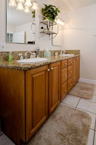 This modern bathroom has a vanity mirror and double sinks.