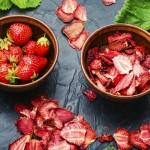 Dried summer berry,fruit dessert.Strawberry chips,berry sweetness in bowl.Dried strawberry slices