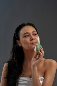 young-asian-half-naked-woman-using-organic-soap-facial-sponge-cleaning-face-posing-against-dark-background-young-asian-217497903